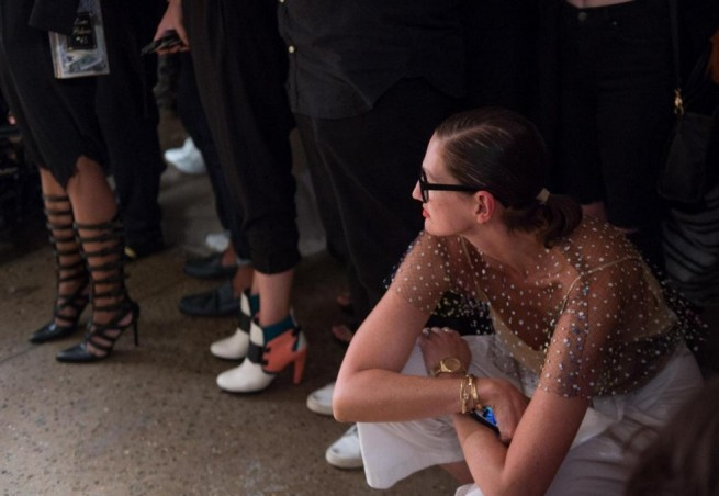 Creative director and president for J.Crew Jenna Lyons kneels as she looks on as the Chromat 2016 Spring collection is modeled during Fashion Week Friday, Sept. 11, 2015, in New York. (AP Photo/Bryan R. Smith)