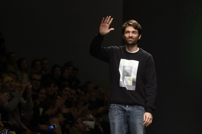 Designers Massimo Giorgetti greets the audience at the end of the show for fashion house MSGM at the women Fall / Winter 2015/16 Milan's Fashion Week on March 1, 2015. AFP PHOTO / OLIVIER MORIN